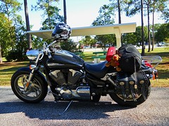 Rudolph at the Rest Stop (Zoom Lens) Tags: travel motion bike speed fun freedom movement tour ride scooter melissa adventure cycle motorcycle rudolph sled sleigh touring putt thrill melissaandme rudolphtherednosedreindeer johnrussellakazoomlens copyrightbyjohnrussellallrightsreserved 80cubicinches lifeon2wheels