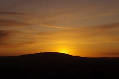 Early riser (Sundornvic) Tags: county morning light sky sun silhouette clouds sunrise glow shropshire hills wrekin haighmondhill