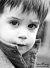 when the eyes talk.. (Zaina Al-Sanea) Tags: portrait blackandwhite bw white black look childhood boston kids photography kid eyes child innocent enzo zaina alsanea