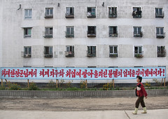 Propaganda billboard in Chilbo streets - North Korea (Eric Lafforgue) Tags: war asia korea asie coree northkorea dprk coreadelnorte nordkorea 9865    coreadelnord   insidenorthkorea  rpdc  kimjongun coreiadonorte