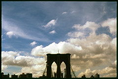 brooklyn beauty. (Vitaliy P.) Tags: street new york city nyc bridge sea sky film brooklyn clouds analog port 35mm 50mm nikon downtown fuji manhattan f14 south slide scan velvia epson gothamist v600 fm10 vitaliyp gettylicensed