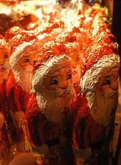 So many Santas! (Liskabub) Tags: santa christmas winter red food colour festive focus edinburgh dof sweet bokeh chocolate stall depthoffield figure fatherchristmas santaclaus stnicholas celebrating germanmarket 111210