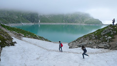 A family walk around the Weisee Glacier world (Bn) Tags: park blue summer mist mountain holiday snow man ski alps ice rock misty fog clouds bench walking geotagged hope austria frozen wooden high topf50 sitting random hiking altitude low year trails peak panoramic glacier suddenly thoughts alpine national journey experience thinking dreams leisure descend mountainside stool staring stroll better thick fascinating hohe slopes phenomenon offpiste bankje stausee uttendorf gletsjer tauern 50faves rudolfshtte weissee panview tauernmoossee 2315m geo:lon=12618613 geo:lat=47127235 granatspitz