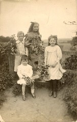 The darling buds of May (c.1905) (pellethepoet) Tags: family flowers girls boys kids sisters children brothers postcard siblings photograph stile rppc realphotopostcard