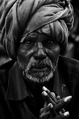 When the eyes have a story of their own... (Rakesh JV) Tags: poverty life street old portrait india white man black guy photography nikon sad humanity expression indian south ngc 85mm age depressed turban wisdom nikkor f18 chennai better bnw jv longing rakesh cwc rjv clickers mylapore d7000 chennaiweekend