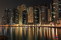 night before new year (japzky) Tags: city light reflection building water night marina hotel dubai corniche dubaimarina yath