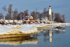 """Winter Reflections""  Point Aux Barques Lighthouse ~  Port Hope, Michigan (Michigan Nut) Tags: trees winter usa lighthouse snow reflection ice nature water sunrise harbor midwest lighthouses michigan shoreline floating historic greatlakes birch beacon icicles lakehuron snowscape iceburg pointauxbarqueslighthouse"