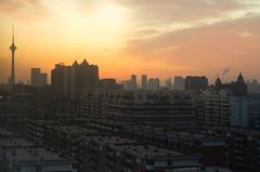 Glorious Sunrise (7/52) (Jeremy Jason Tan) Tags: china city sky orange sunrise buildings landscape 50mm nikon apartments glow nikkor dslr tianjin residentialarea dx nikkor50mmf18d afd50mmf18 tianjinchina d7000 nikond7000