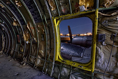 nightmare at 20,000 feet. tucson, az. 2015. (eyetwist) Tags: old longexposure arizona lightpainting west dusty abandoned graveyard metal night danger warning dark airplane nikon rust desert tucson decay interior aircraft military wing rusty cargo storage fullmoon american engines moonlight junkyard hatch boeing hulk airforce nikkor usaf propeller scrap derelict nocturne boneyard wrecked props gremlins tanker fuel sonorandesert placard coldwar radial freighter twilightzone emergencyexit afb airtoair dented davismonthan prattwhitney amarc refueling kc97 eyetwist stratofreighter npy kc97g nightmareat20000feet 1024mm amarg d7000 eyetwistkevinballuff 1024mmf3545g gasstationinthesky pw3350 theressomethingoutonthewing