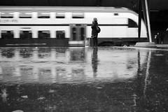 Smoke (maekke) Tags: urban bw woman reflection rain architecture train switzerland noiretblanc pov smoke streetphotography sbb pointofview trainstation calatrava fujifilm zrich ch zvv stadelhofen 2016 x100t