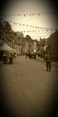 The Lone Soldier (GothiclyInclined) Tags: england sepia vintage soldier gun military 1940s cobbles atmospheric westyorkshire haworth bunting britishflag homeguard lonesoldier 1940sweekend brontecountry haworthmainstreet