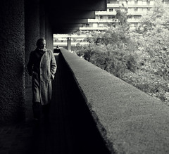 Barbican Centre - London Street Photography (Nicholas Goodden) Tags: city people urban london lines vintage photography vanishingpoint cool solitude candid citylife streetphotography olympus retro barbican londres streetphoto unposed londra brutalist urbanlife urbanphotography londoners streetphotographer barbicancentre photoderue notposed streetsoflondon urbanphotographer mirrorless microfourthirds
