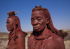 Himba Women, Angola (Eric Lafforgue) Tags: africa two people woman horizontal female standing outside outdoors person necklace women exterior bluesky tribal ornament bodypainting 370 tribe ochre hairstyle humanbeing plaits headdress himba colorphoto angola headwear headgear southernafrica herder ethnicgroup traditionalhairstyle    traditionalornament otjize      herdingpeople erembe erembeheaddress