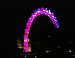 London Eye changing colours (JimmyMac210) Tags: london zoom londoneye celebration viewfrommyflat changingcolours happynewyearseve inhackney pinktopurple absolutelyperrrfect still2011 blackandwhitewithcolourselective