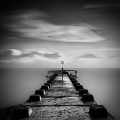 Bournemouth Groynes (paulwynn-mackenzie.co.uk) Tags: longexposure sea blackandwhite bw mist seascape nature clouds photoshop photography pier seaside nice movement waves quiet sony relaxing kitlens clarity a33 structure walkway processing alpha dslr vignetting tones groyne vignette bournemouth minimalist slt pp lightroom postprocessing