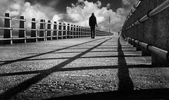 Rendez vous (woolyboy) Tags: uk people bw lines pier vanishingpoint coastal newhaven eastsussex eastpier leadin woolyboy
