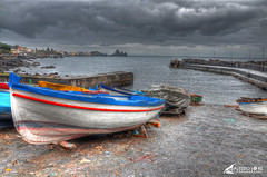 A Bad Day To Take Photos, Aci Castello : HDR (alexbravewolf) Tags: light shadow sky italy cloud white black color colour beautiful field rain rock clouds wow one harbor boat photo fantastic nikon rocks paint pretty italia colore image very little harbour good expression background gorgeous awesome extreme great group picture lot award superior super best explore more most creation rainy winner stunning excellent sicily plus much greatest colourful draw rank incredible castello hdr breathtaking sicilia exciting aci trezza 18105 acitrezza phenomenal acicastello tonemapped flickr500 d7000 alexbravewolf
