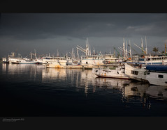 Bira harbour 4. (J.M.Fransen (jero 053)) Tags: light sunset panorama sun beach canon indonesia landscape island evening cool dock asia exposure mood harbour culture surreal human canon5d shadowplay pure tones indo lumires lightroom celebes magnification lightfall telephotography
