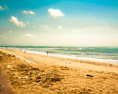 Kuta Beach (Raji Vathyam) Tags: trees sea bali sun beach water umbrella canon mall indonesia sand palm shore noon 1855mm kuta