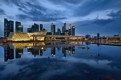 Singapore City Skyline from Marina Bay at Blue Hour - HDR (David Gn Photography) Tags: city travel sunset sky reflection tourism glass skyline architecture modern night evening pond singapore southeastasia cityscape waterfront skyscrapers dusk scene structure esplanade boardwalk cbd bluehour hdr centralbusinessdistrict singaporeriver marinabay 3xp marinabaysands canoneos60d sigma1020mmf35exdchsm