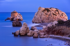 Aphrodite's Rock Paphos Cyprus (Allard Schager) Tags: longexposure november blue autumn sea seascape fall beach water strand landscape island mirror still nikon rocks waves venus spiegel country herfst goddess cyprus pebbles le bluehour aphrod