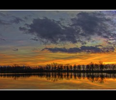 No title this time (Wim Koopman) Tags: blue trees sunset sky orange lake holland water netherlands dutch yellow clouds reflections photography gold photo pond magic stock nederland silhouettes dramatic line hour stockphoto linedup stockphotography goudriaan wpk slingeland