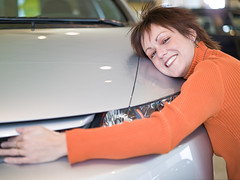 1001731092 (ecaoftulsa) Tags: new car smiling hugging automobile funny adult humor indoor redhead showroom vehicle customer cropped brunette redhair eyesclosed consumer caucasian headandshoulders smitten embracing materialism onepersononly midadultwoman 3035years 3540years casualattire 1001731092 25022103