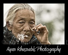 The old lady of Sillery - Bengal (India) (A y A n) Tags: old trip travel woman west face lady canon photography photo expression smoke north age 200 l aged 70 bengal sikkim biri bengali ayan beedi sillery gaon 400d khasnabis ayancoin