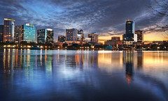 Orlando Florida Skyline (Sky Noir) Tags: county city travel sunset orange lake building skyline night reflections dark photography evening us orlando scenery downtown cityscape exterior unitedstates florida cloudy dusk unitedstatesofamerica scenic fl fla eola skynoir bybilldickinsonskynoircom