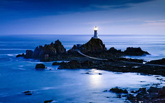 La Corbire Lighthouse, Jersey, Channel Islands, UK (statm5) Tags: ocean water night rocks lighthouses moonlight