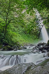 waterfall near arenal volcano (gruntpig) Tags: trees costa green fall wet water flow volcano waterfall costarica rocks branches rica boulder hdr arenal torrent