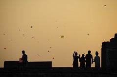 The Uttarayan puppet theatre (Saumil U. Shah) Tags: sunset wallpaper india kite color colour colors silhouette festival evening colours silhouettes kites string gujarat ahmedabad uttarayan sankranti shah makar patang  saumil firki incredibleindia uttran uttaran    saumilshah