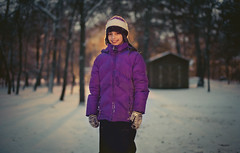 Winterized. ([the] Printer) Tags: trees winter portrait snow cold girl smile night canon outside outdoors kid twilight dof bokeh dusk daughter shed minneapolis snowing snowfall tundra backlighting 50mmf14 iso6400 5dmii