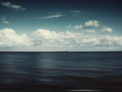 In the middle of the sea (MOSTAFA HAMAD | PHOTOGRAPHY) Tags: pictures camera blue trees sunset sea sky italy sun black mountains color tree art love nature water clouds sunrise canon germany landscape photography is meer wasser europa day alone fotografie sonnenuntergang iraq natur 110 himmel wolken berge ixus middle landschaft sonne bume sonnenaufgang hamad baum  mostafa in       iaq               mostafahamad