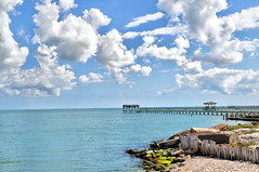 Fishing Pier at Aransas Bay in Rockport, Texas (Ronnie Wiggin) Tags: ocean sea seagulls beach pier fishing nikon waves texas pelican egret beachsunset greategret rockport fishingpier wildliferefuge jetties gulfcoast d300 texasgulfcoast beachsunrise oceanwa