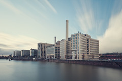 Heating Plant (Philipp Klinger Photography) Tags: longexposure bridge blue light shadow red orange sun plant water glass lines architecture modern triangles skyscraper canon reflections river germany boats deutschland b