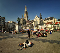 Soaking Up the Sun in Antwerp, Belgium (` Toshio ') Tags: city people history church girl statue architecture square europe european cityscape belgium belgian antwerp oldtown europeanunion toshio groenplaats pagestoshiokishiyama209875339045240skwall