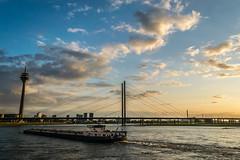 Warm evening in Dsseldorf Ii (Job I) Tags: sunset sky sun reflection water clouds river germany landscape europe ship cityscape wide nrw dusseldorf rhine rhein