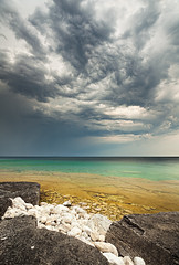 Threatening Skies (waterfallout) Tags: park cloud white lake ontario canada storm black cold beach water weather rock clouds james bay skies threatening turquoise bruce north shoreline carribean stormy national georgian thunderstorm storms peninsula huron halfway logdump hackland