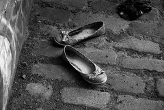 Shoes (Rachel.Piper) Tags: blackandwhite woman london abandoned girl alone young dirty dirt cotton derelict deserted dlr wrecked overground