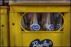 Empty Bireley's bottles (Eric Flexyourhead) Tags: city urban detail yellow japan tokyo bottles empty   soda empties crate taitoku fragment yanaka taito   bireleys olympusep1 panasoniclumix20mmf17