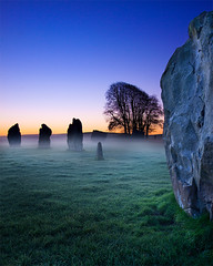 Avebury Dawn (Chris Beard - Images) Tags: sun mist colour silhouette stone sunrise landscape landscapes countryside ancient standingstones colours religion dramatic historic colourful wiltshire nationaltrust prehistoric avebury worldheritage morningmist mistymorning mistydawn