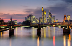 Frankfurt skyline at dusk in HDR (Circum_Navigation) Tags: bridge blue sky urban building tower skyline architecture facade skyscraper germany office twilight cityscape hessen dusk frankfurt district main bank hour lightning financial hdr finance ignatz bubis