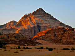 As Sunrise hits Wadi. By Ian Layzell (IANLAYZELLUK) Tags: november camping light camp sun sunlight mountain mountains nature rock stone sand rocks desert natural hiking stones wadirum hill earlymorning middleeast hills adventure jordan adventures lawrenceofarabia wadi deserts jordanian middleeastern treking valleyofthemoon sunrisemountain desertmountain desertrock desertmountains rockdesert november2011 transformersrevengeofthefallen ianlayzell sunrisehittingmountain jordanvalleyofthemoon walkingacrossdesert
