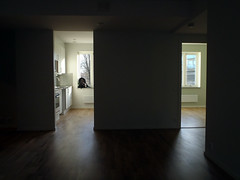 Moving: new place, empty and waiting (Eva the Weaver) Tags: moving boxes 00