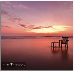 sun sets for one last time in the year 2011.. (PNike (Prashanth Naik)) Tags: sunset red sea sky orange india colors clouds table chair nikon asia long exposure wind goa goodbye konkan 2011 d7000 pnike