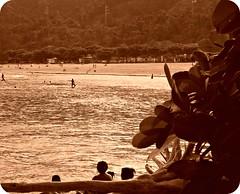 Don't point!!! (Happy Photographer day) (NatiLady) Tags: wood houses brazil people folhas beach water leaves rio gua sepia swim fun mar sand pessoas nikon hidden diverso nadar vegetation casas rvore madeira fallentree vegetao praiabrava escondida