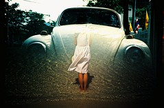 Surrealism (saviorjosh) Tags: travel white holiday classic beach girl car thailand lomo lca xpro lomography dress kodak doubleexposure bangkok sandy beetle surreal slide crossprocessing e100vs phiphiisland clearwater kophiphi splitzer