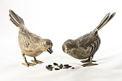 metal birds gotta eat! (loco's photos) Tags: macro birds pentax seeds sunflower kr figurine lighttent lightbox strobe offcameraflash metalbirds strobist pentaxkr panagor9028