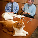 Cyrano relaxes on the table while industrial and systems engineer Dr. Ola Harrysson (left) and orthopedic surgeon Dr. Denis Marcellin-Little talk to the media about their collaboration.